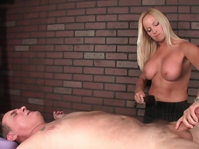 Blonde masseuse in corset gives a handjob hither submissive buyer