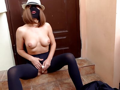 Harpy In the matter of A Mask And Tight Black Pantyhose With A Hole In the matter of Her Pussy Masturbates With A Vibrator Under