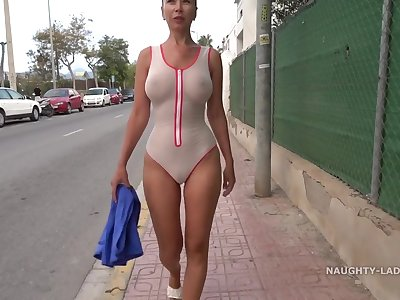 Naughty Russian mom in totally see thru swim suit unclouded outdoors