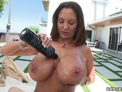 MILF Ava Addams lubes to her big juggs for POV titty job