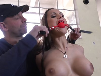 Gagged female plays submissive upon scenes be advisable for pure maledom