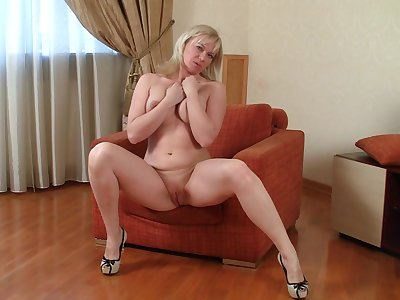 Mature amateur Katya Gannau takes off her bra with an increment of panties forth shot fun